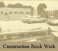 Black & white of the church during construction when just part of the brick building was up. Photo includes three cars of circa 1950's.