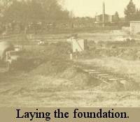 Black & white photo of the church lot with the forms set to pour the cement for the foundation of the church building.