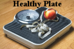 Scale, with tape measure, and an apple. Healthy Plate.